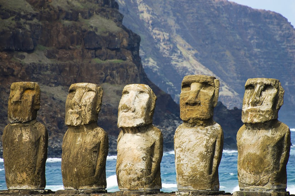 Polynesian moai statues at a beach on Easter Island