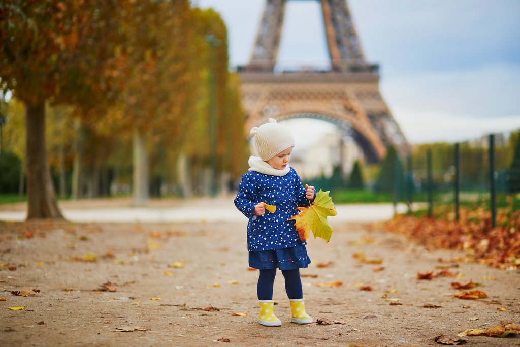 Young child enjoying autumn in Paris