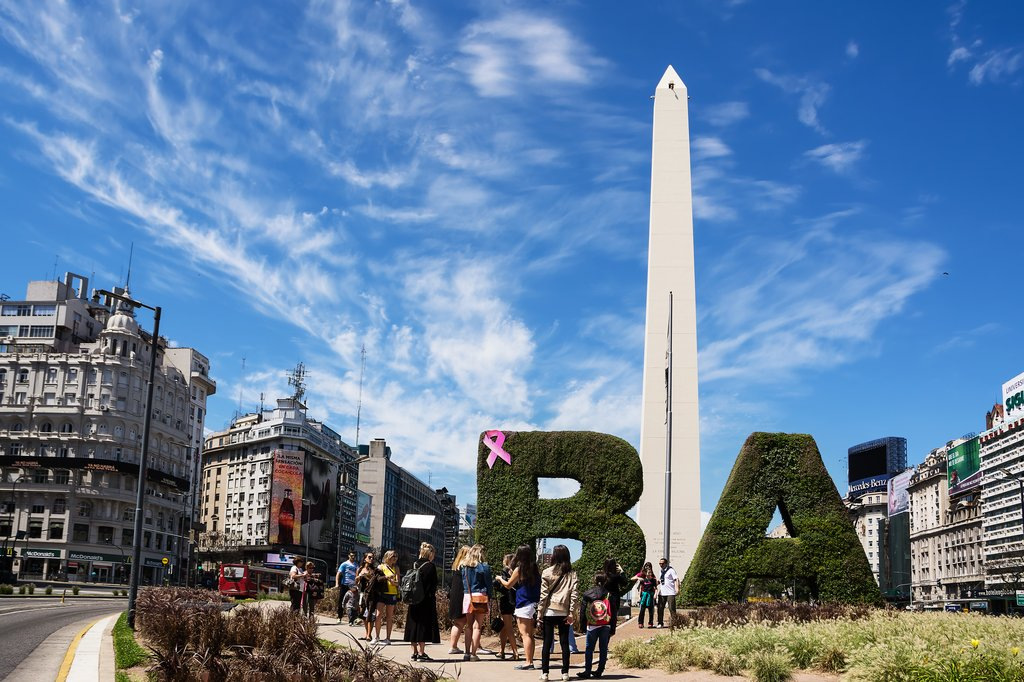 Tourists in front of the obelisk marking the beginning of Argentine Independence in central Buenos Aires