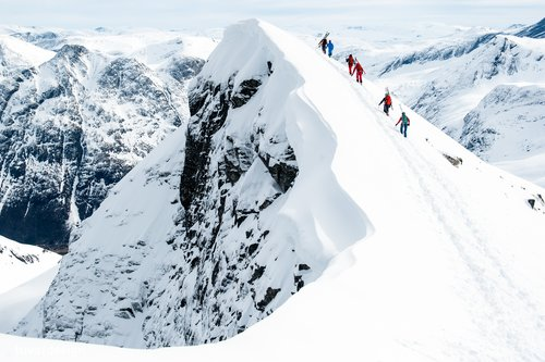 Climbing to a snow-covered peak