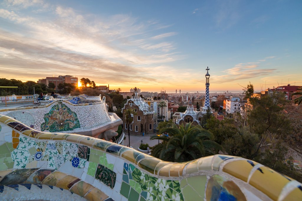 Explore Parc Guëll and watch the setting sun over Barcelona
