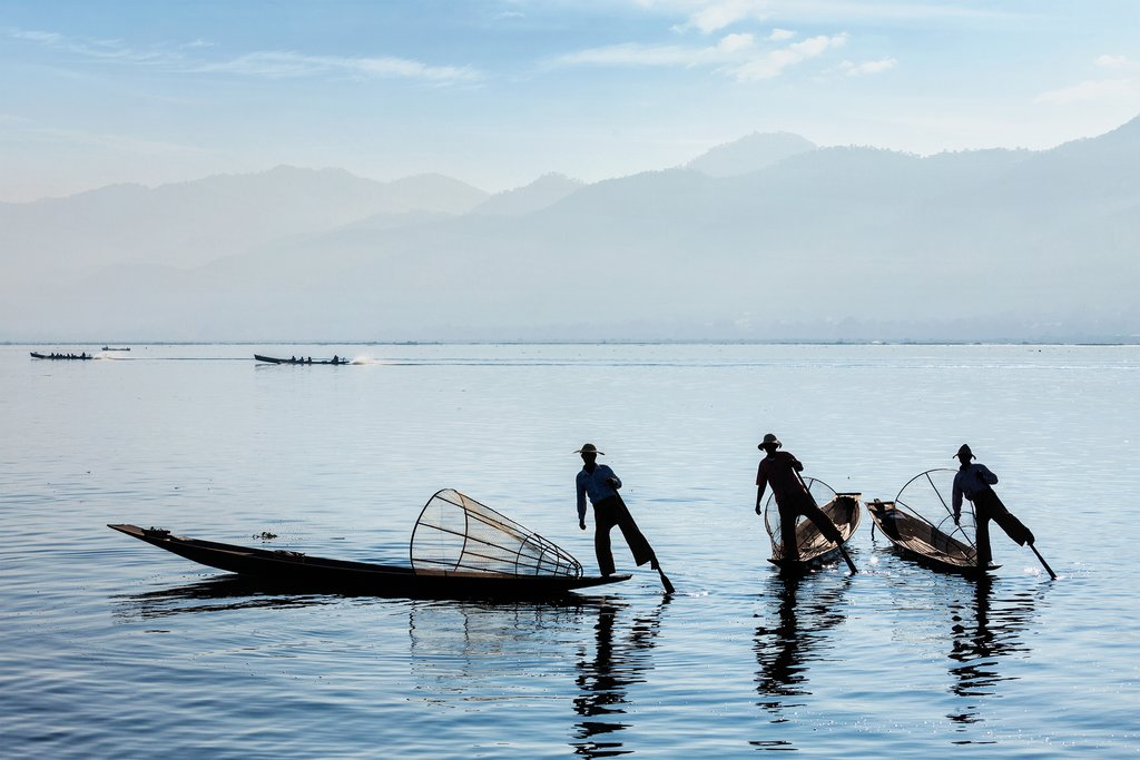 Fisherman on serene Inle Lake
