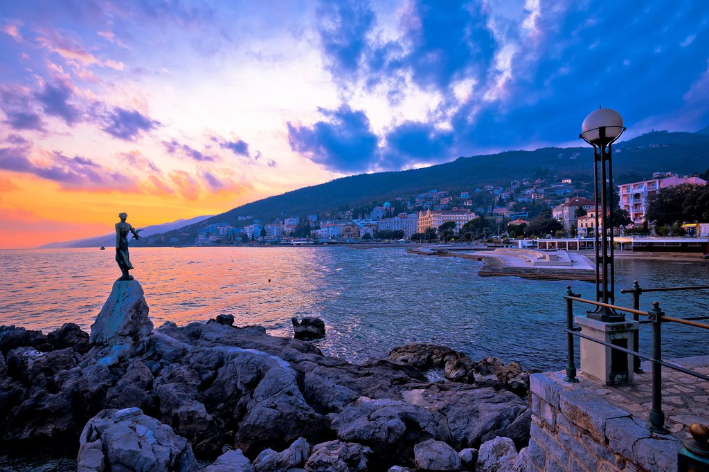 Sunset over Opatija's Maiden with the Seagull sculpture