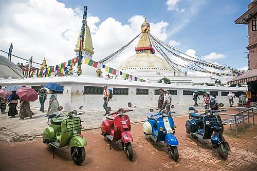 Vespa scooters in front of Boudhanath Stupa in Kathmandu