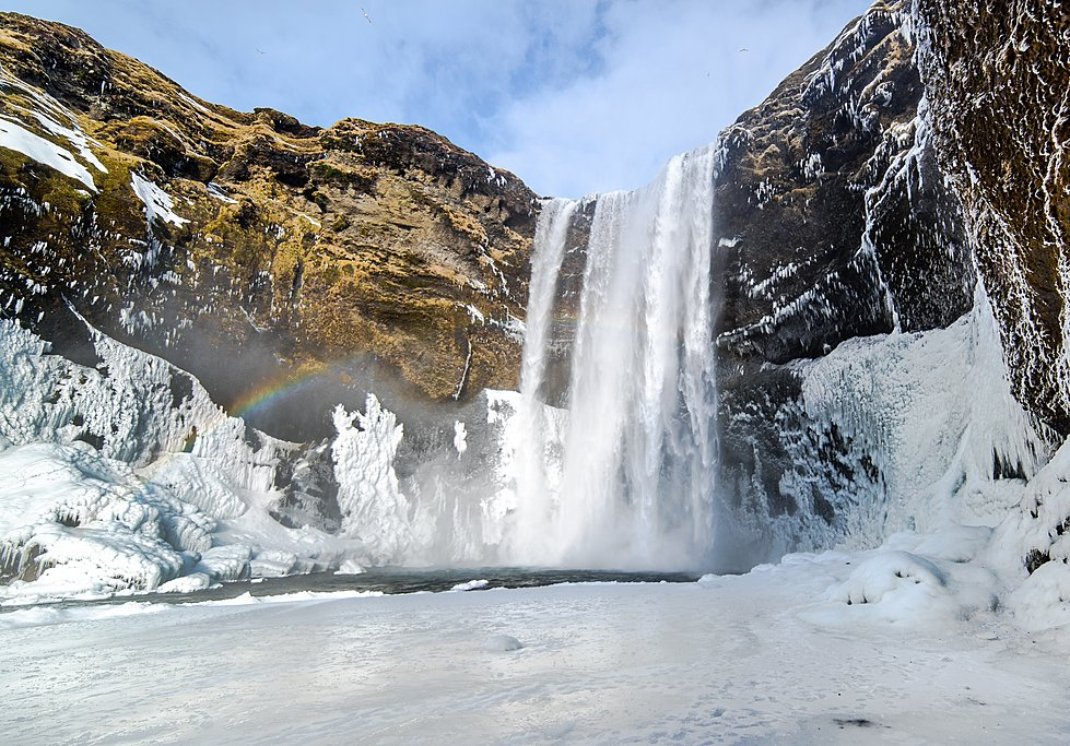 Skogafoss Waterfall, frozen in the winter
