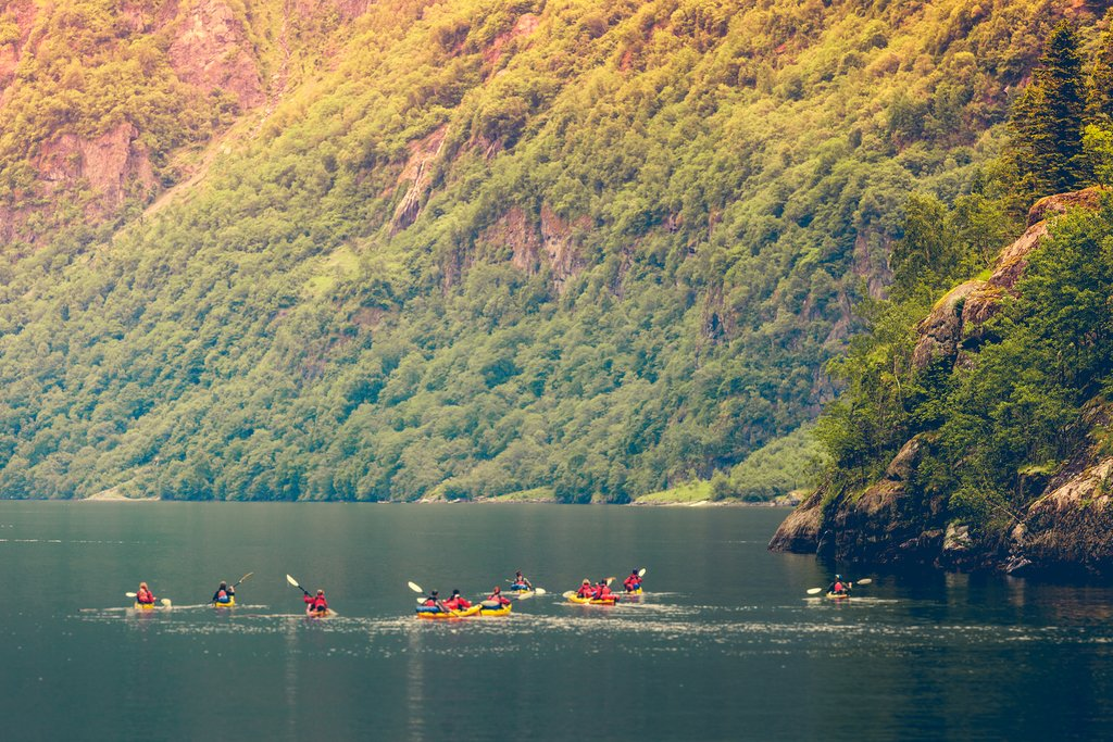 Take a guided kayaking tour in the western fjords