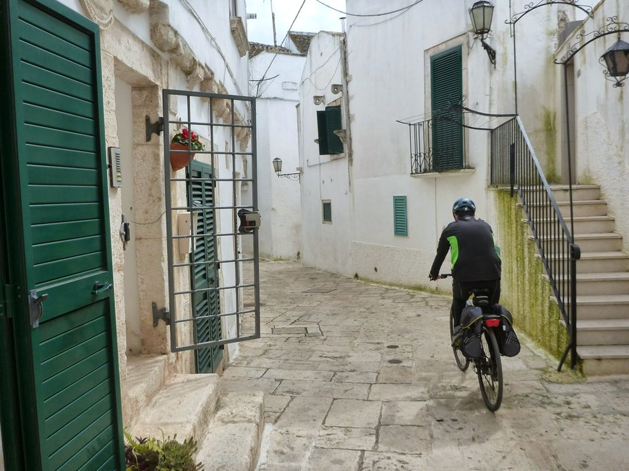 A cyclist in the narrow streets of Puglia