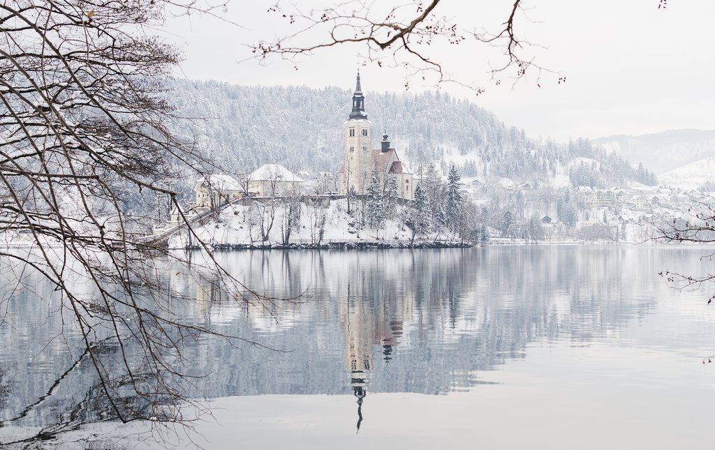 Covered in a veil of snow, Bled Island feels like a place right out of a fairy tale