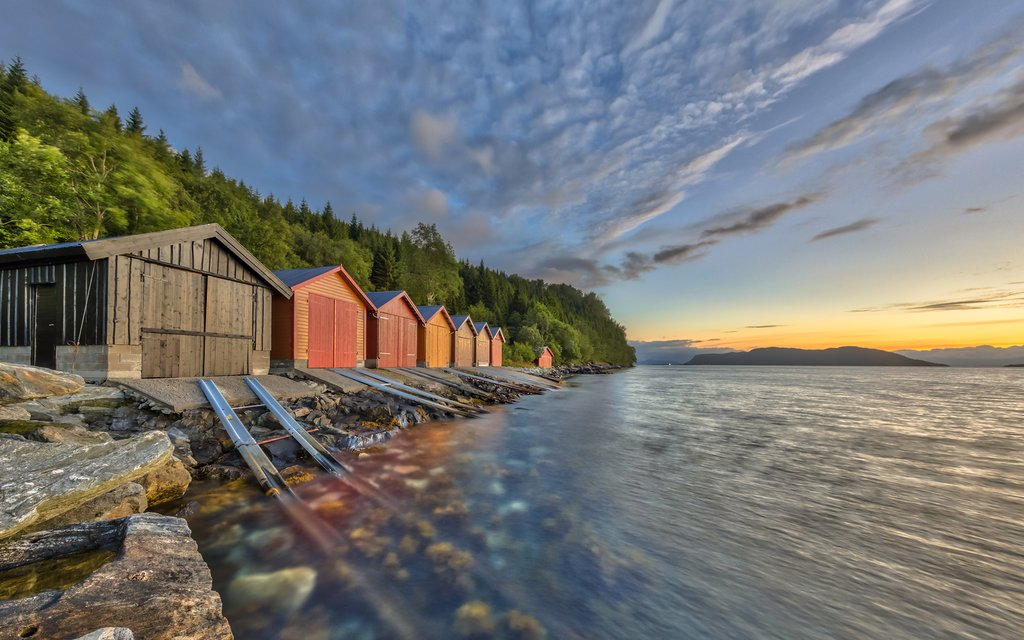 Boathouses in a fjord near Ålesund
