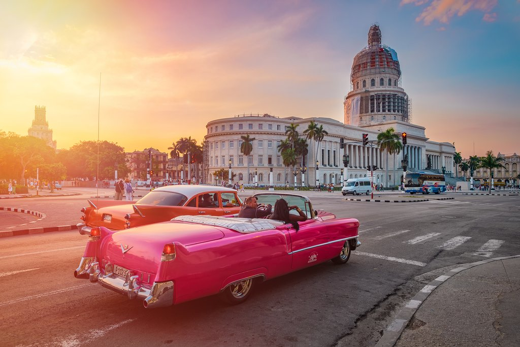 Classic car and Capitolio at unset in Havana