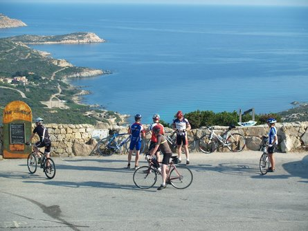 Cyclists overlooking the bay in Calvi