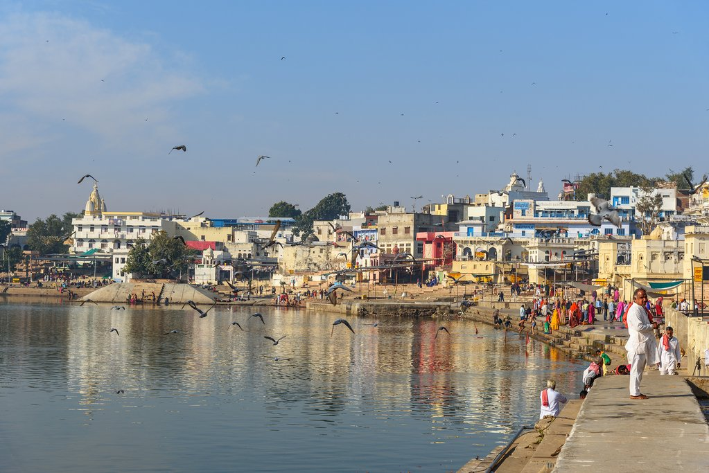 People bathing in Pushkar holy lake in Rajasthan