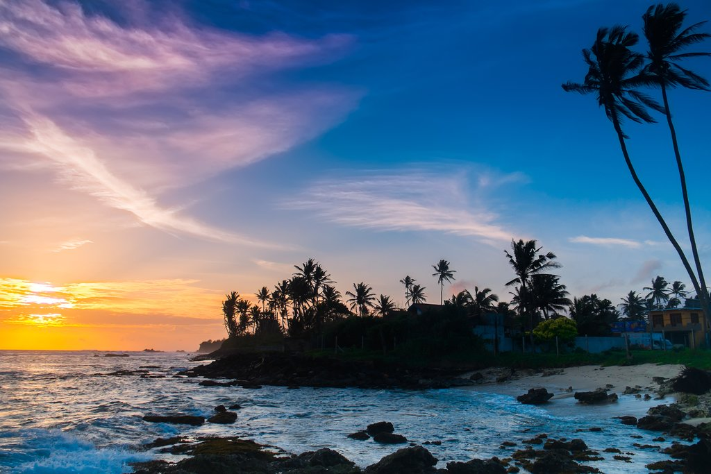 Take in the setting sun from a beach in Tangalle