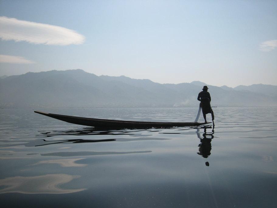 Fisherman on serene Inle Lake