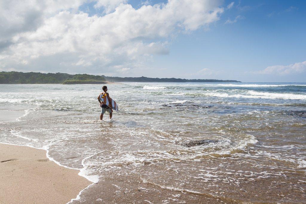 Surfer in Playa Tamarindo