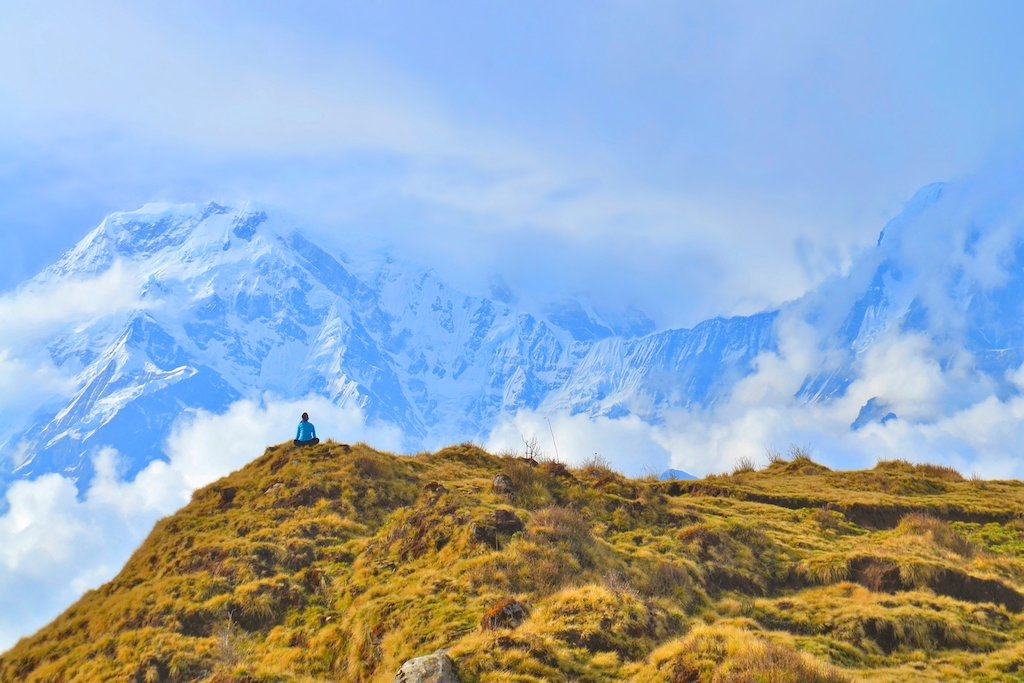 A young woman meditates in the Annapurnas