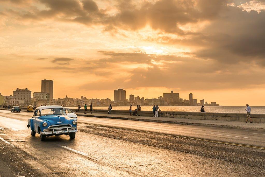 A classic car cruising along Havana's Malecón
