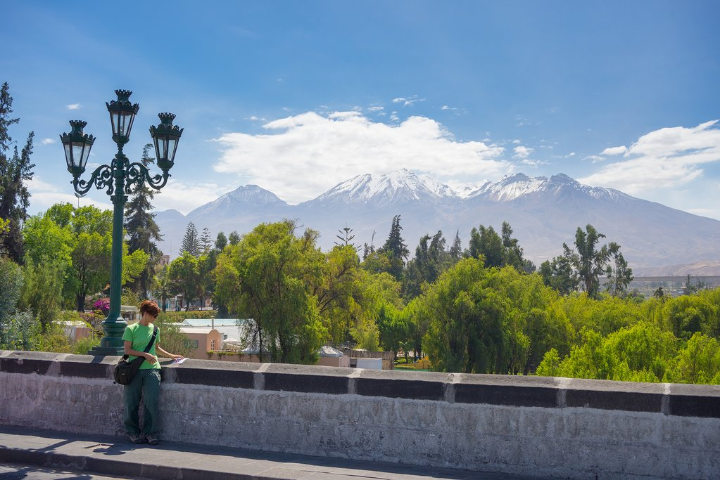 Reading with a scenic backdrop in Arequipa, Peru