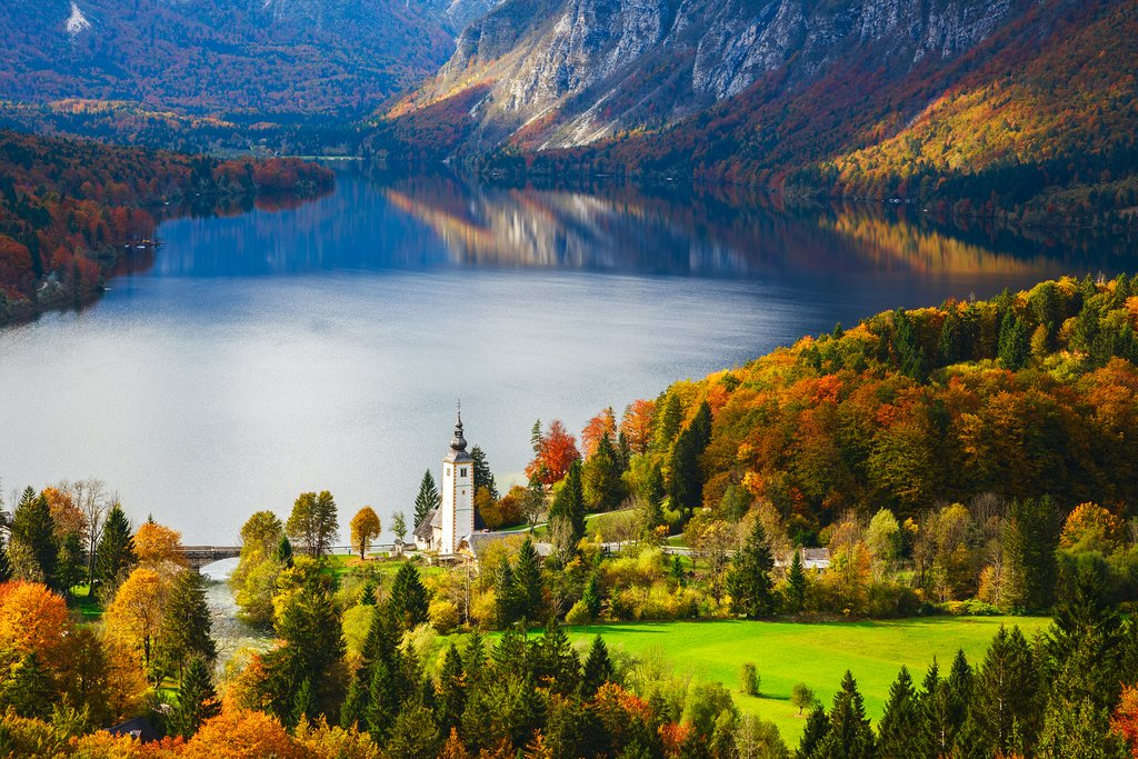 Admire the fall foliage that line the banks of Lake Bohinj