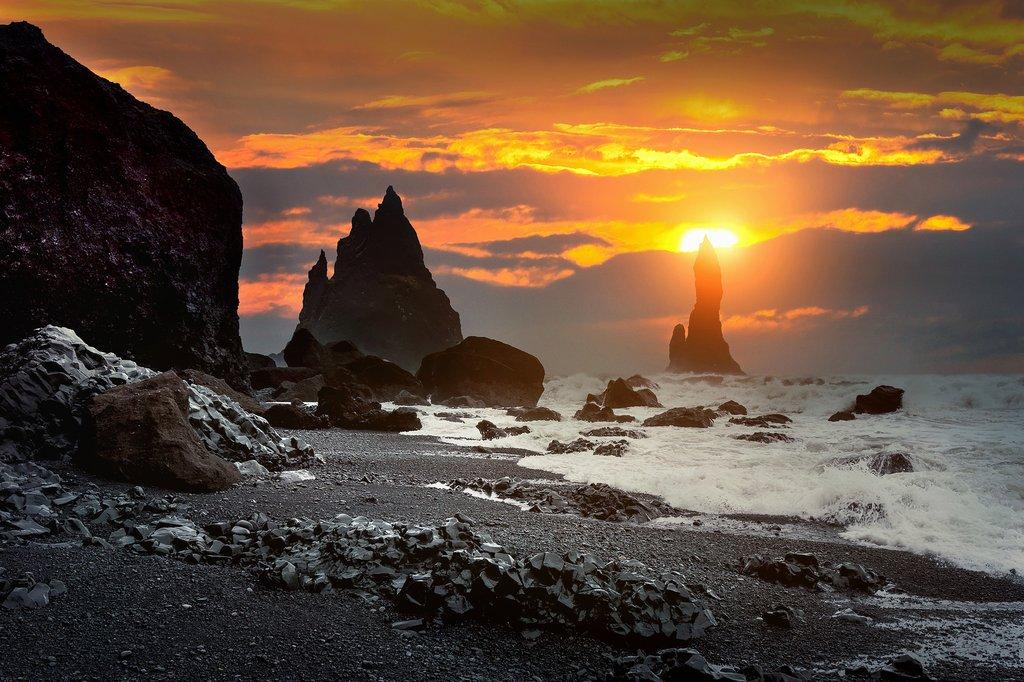 Take in the setting sun from Reynisfjara beach