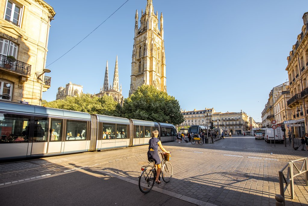 See the city's historic and modern architecture by tram and bicycle