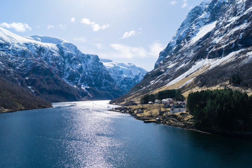 Cruise through the snowy fjords on the Hurtigruten