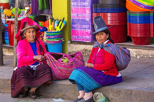 Traditionally dressed Peruvian women in a local marketplace