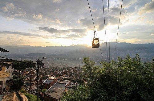 Medellín's cablecar system ascending a hill at dusk