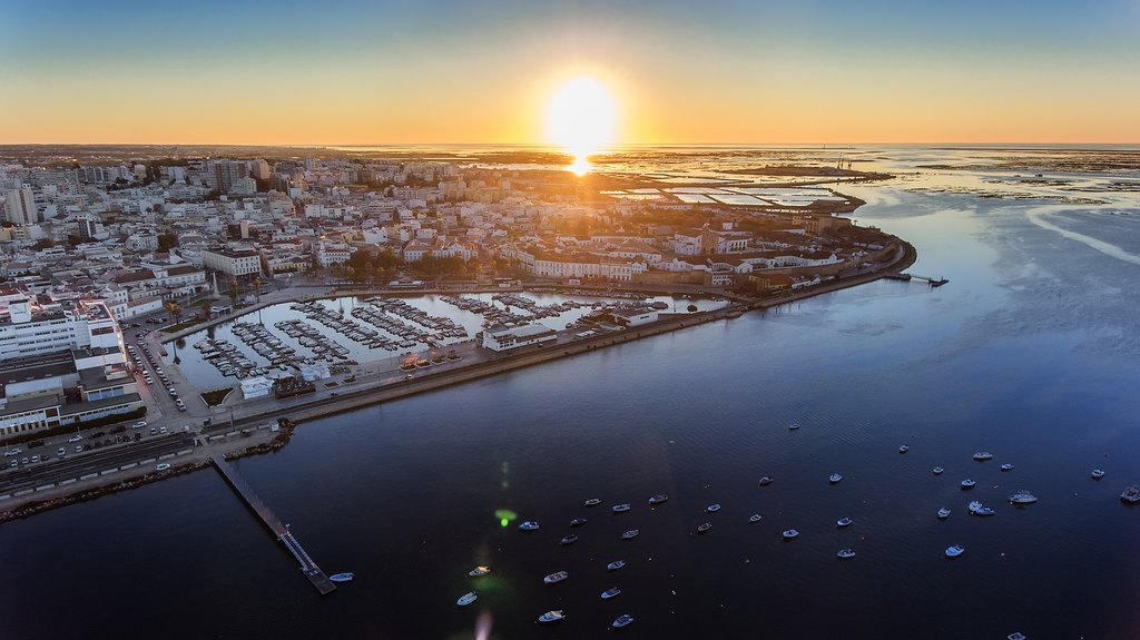 The sun sets over the Ria Formosa and Faro
