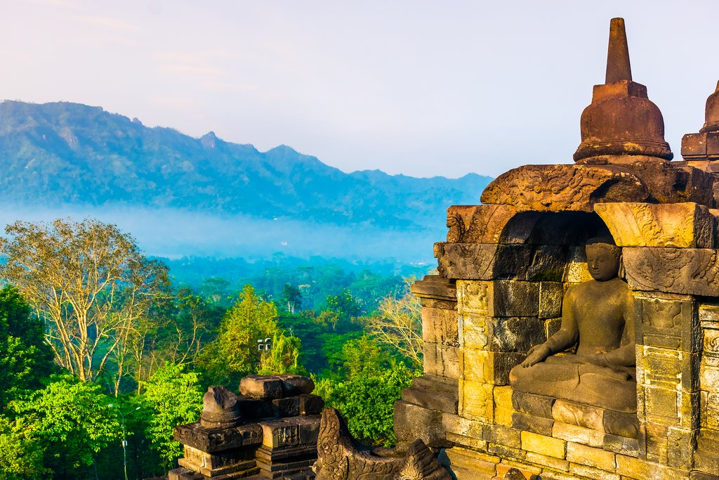 The morning sun washes Borobudur in golden light