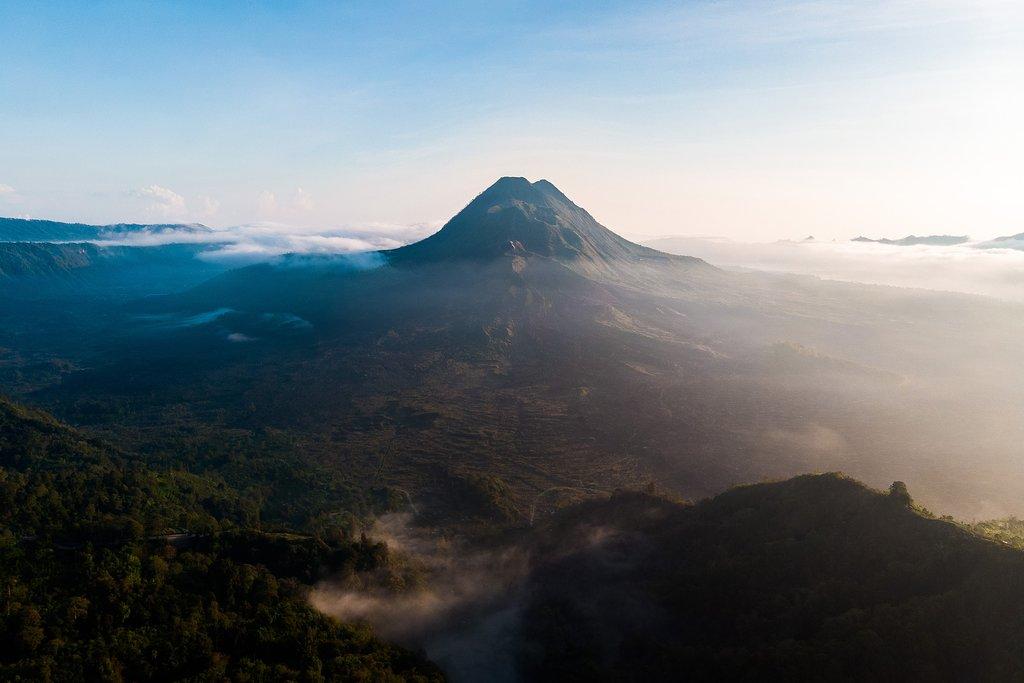 Sunrise and mist at Batur volcano, Kintamani, Bali, Indonesia.
