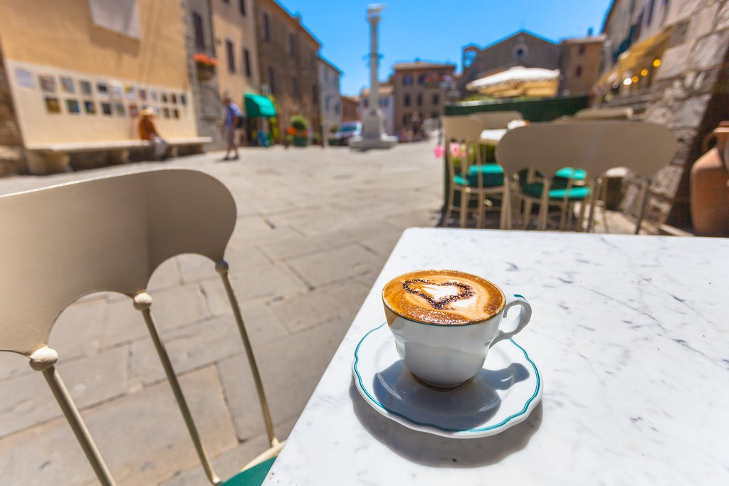 Cup of coffee in an Italian piazza
