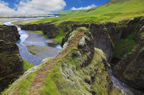Kirkjufellsfoss Waterfall and Kirkjufell Mountain, along the Snaefellsnes Peninsula