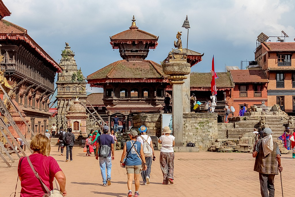 Tourists walking around a temple in Kathmandu, Nepal
