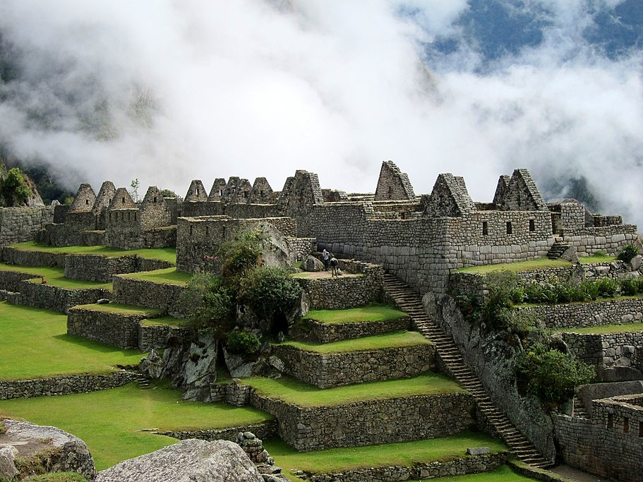 Morning fog enshrouds the Inca ruins of Machu Picchu