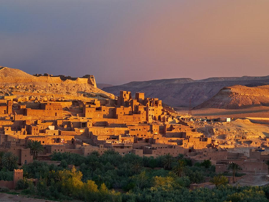 The sun sets over the Ouarzazate River and Aït Benhaddou