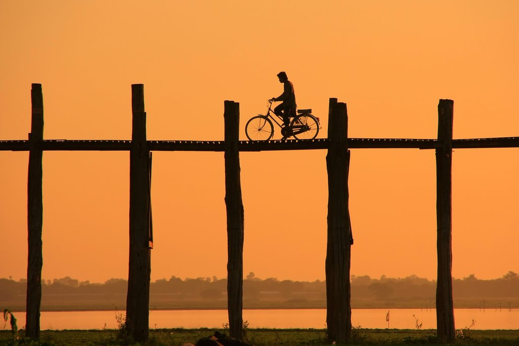 Biking cross the U Bein Bridge