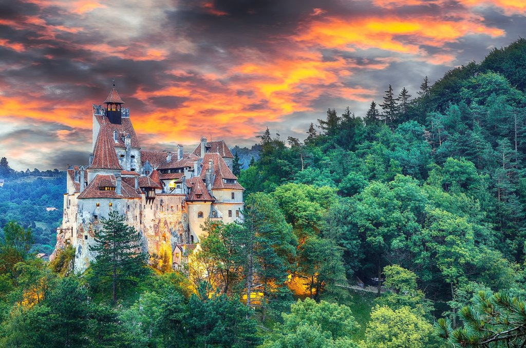Catch a sunset over famous Bran's Castle outside of Brașov