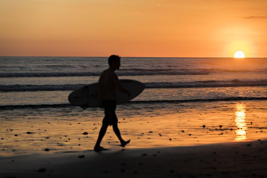 Go surfing in Tamarindo Beach