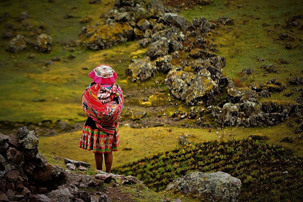 Girl walking home in the Lares Valley