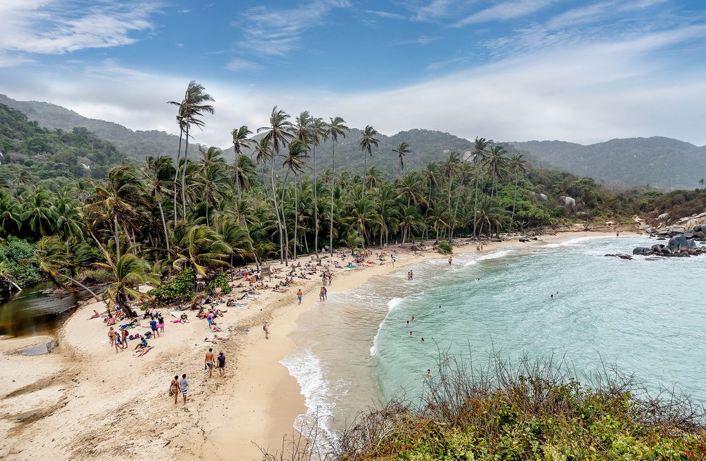 Families enjoy the beach at Parque Nacional Tayrona