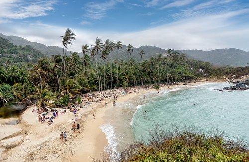 Families enjoy the beach at Parque Nacional Tayrona