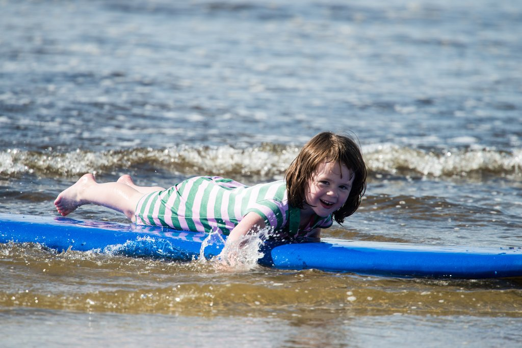 Girl taking surfing lessons in Co. Donegal