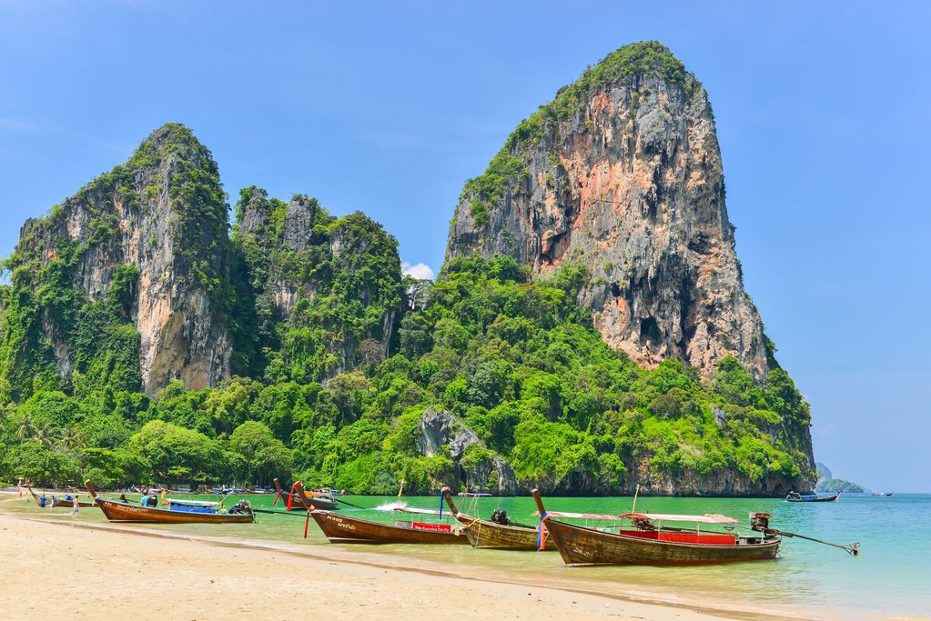 KRABI THAILAND - May 2 2014 : Holidaymakers relaxing on the beach in Rairay Beach Krabi Thailand. Rairay beach is one of famous beach in Krabi. Thailand
