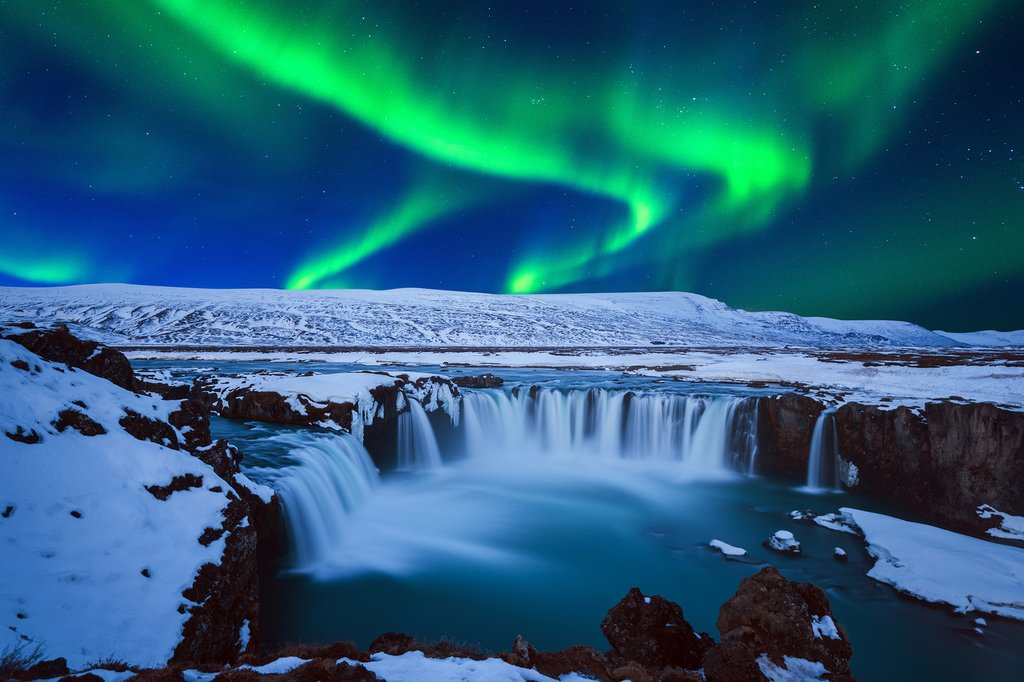 Catch the Northern Lights over a wintry Goðafoss