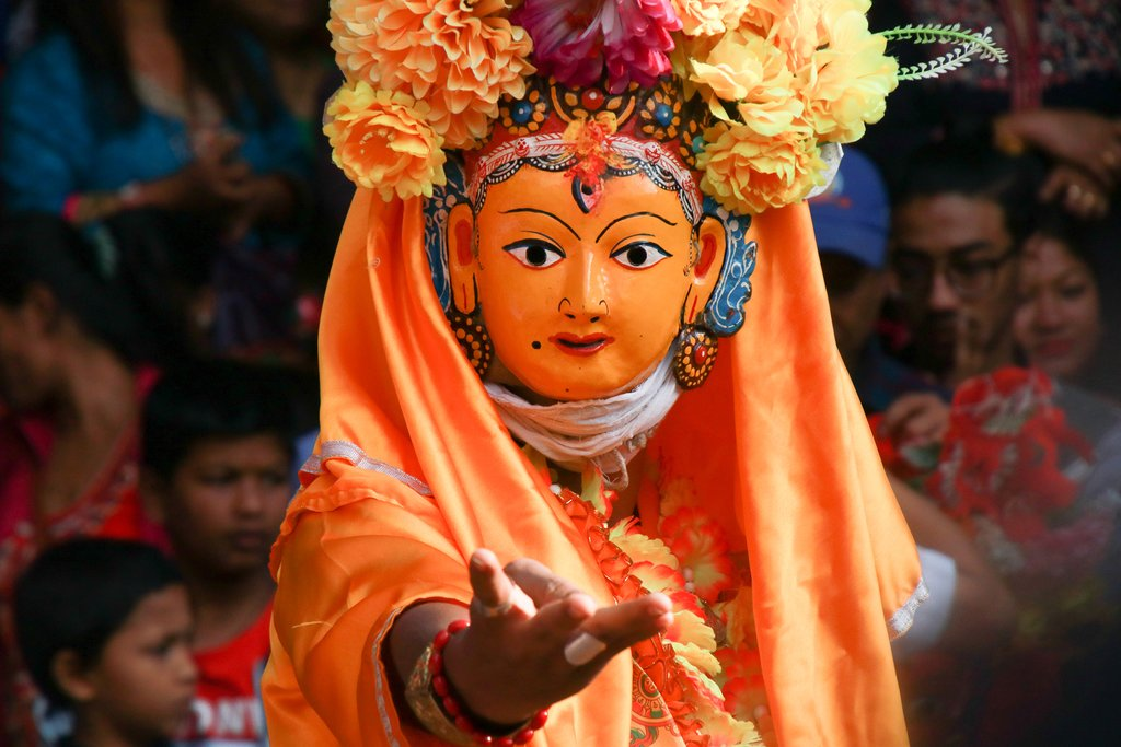 A traditional masked dancer in Patan Durbar Square