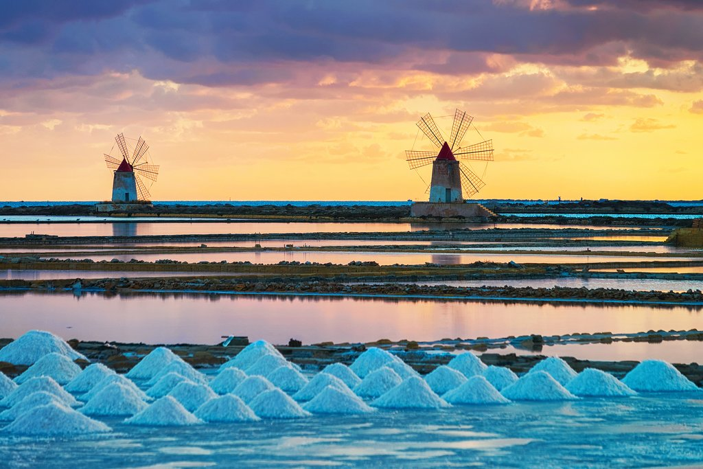 Take in a stellar sunset over windmills and evaporating salt ponds in Trapani