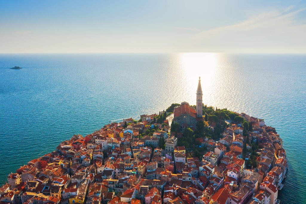 The Church of St. Euphemia marks the beautiful Old Town of Rovinj at sunset