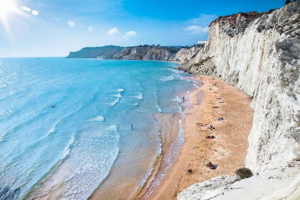 Explore the chalk-white cliffs of Scala dei Turchi before going for a swim