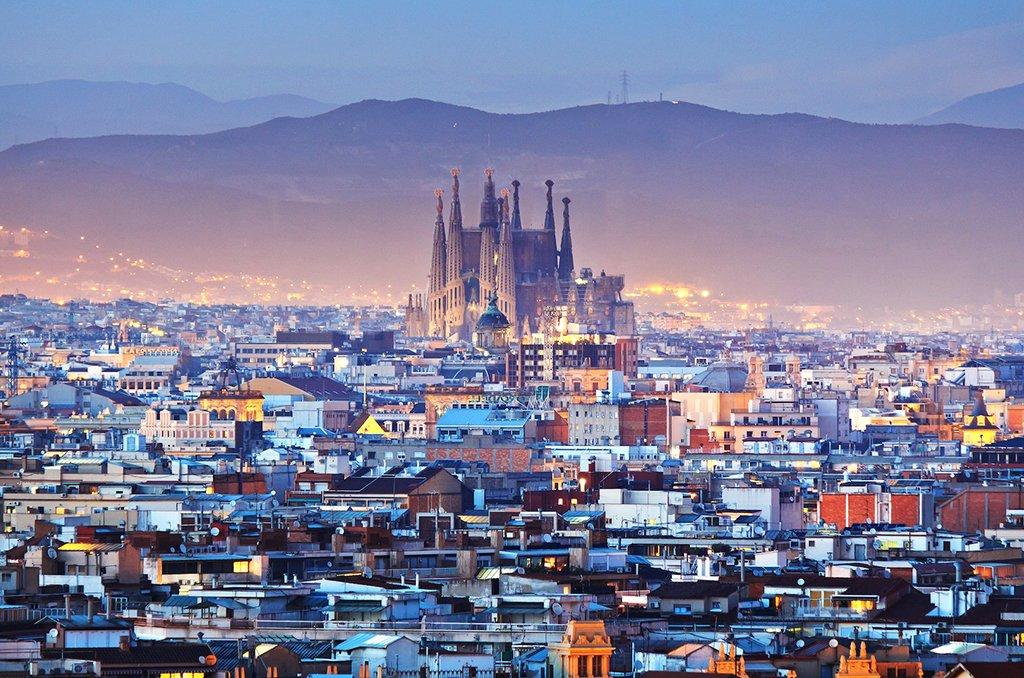 Sunrise over Barcelona's magical skyline.